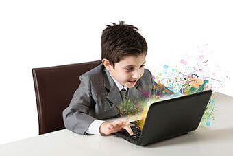 Kid using laptop to learn live online coding